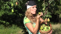 Peasant woman eat pear Stock Footage