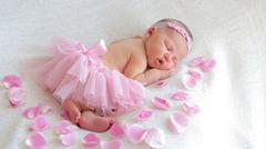 Cute newborn baby girl sleeping - stock photo
