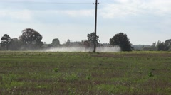 Tractor spray fertilize field with insecticide herbicide chemicals. 4K - stock footage