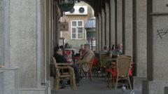 People sitting at Amfora Restaurat in Dolac Market, Zagreb, Croatia Stock Footage