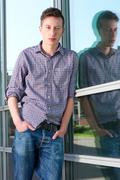 Young man standing alone outdoors Stock Photos