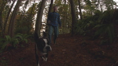 Young Boy Walking Dog on Forest Park trail Stock Footage