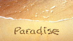 4K Paradise Written in Sand, Tropical White Sand Beach, Sea Waves Background Stock Footage