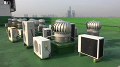 Spinning ventilators, air conditioning equipment, rooftop building, Asia, Korea Stock Footage