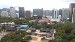 Seoul central business district, old historic royal palace, cathedral, contrast Stock Footage