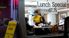 Outside shot of people enjoying food at Chinese restaurant with 4k resolution Stock Footage