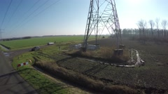 Aerial footage of a transmission tower electricity pylon slowly ascending 4k - stock footage