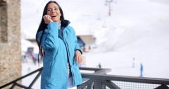 Attractive young woman at a mountain ski resort - stock footage