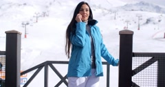 Attractive young woman at a mountain ski resort Stock Footage