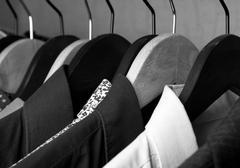 shirts and jackets in wardrobe isolated closeup - stock photo