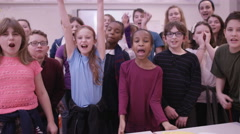 4K Portrait of happy group of children in school classroom Stock Footage
