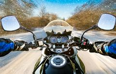 Biker First-person view. Winter slippery road Stock Photos