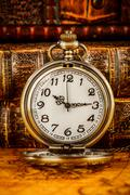 Old Books and Vintage pocket watch - stock photo