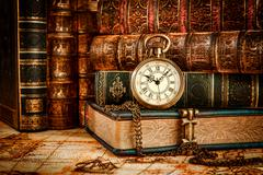 Old Books and Vintage pocket watch Stock Photos