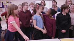 4K Portrait of happy group of children in school classroom Stock Footage