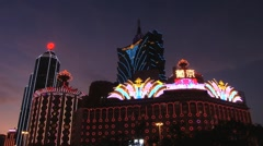 Modern buildings and the Grand Lisboa casino at night in Macau, China. Stock Footage