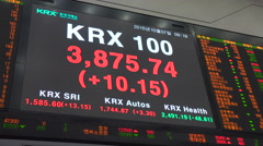 Ticker board displaying live share prices at the Korea Exchange, South Korea - stock footage