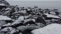 Snowy Coast Rocks and Fog Dolly Right 4K Stock Footage