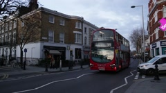 Double Decker red bus in Chelsea, London, England Stock Footage