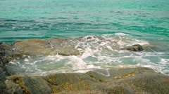 Small Tropical Waves Washing over Boulders. Video UltraHD - stock footage