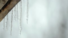 Melting icicles in the spring under the roof. Spring melting of ice. Stock Footage