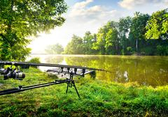 Stock Photo of Fishing rods near river