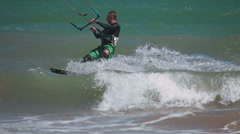 Kiteboarder surfing waves with kiteboard Stock Footage