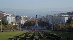Traffic at Marquis of Pombal Square, Eduardo VII Park, long shot, Lisbon Stock Footage
