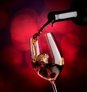 Wine on vinous background - stock photo