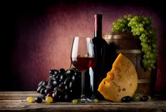 Wine with maasdam - stock photo