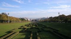 Eduardo VII Park gardens, Marquis of Pombal Square, long shot, Lisbon Stock Footage