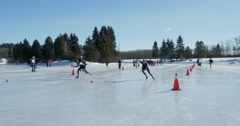 Speed Skaters fly past the camera in Edmonton, Canada. Stock Footage