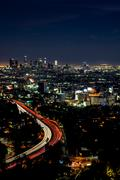 Long exposure night view of Los Angeles downtown and surrounding areas Stock Photos