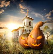 Pumpkins on churchyard - stock photo