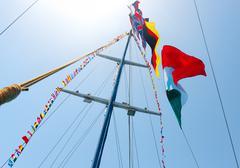 Flags on mast - stock photo