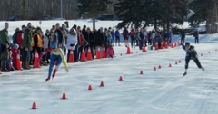 Speed Skaters race down the track at Hawrelak Park in Edmonton, Canada. Stock Footage
