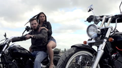 Young hot girl sitting on the bike holding a biker in slow motion Stock Footage