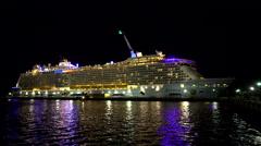 Illuminating cruise ship in the port at night - Anthem of the seas, Bahamas Stock Footage