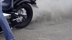 Bike slipping on a spot in slow motion  - stock footage