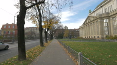 Cars driving by the Croatian State Archives building in Zagreb - stock footage