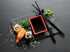 Delicious sushi with sauce - stock photo