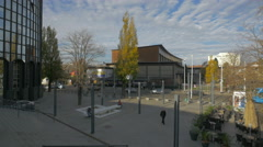 People walking near Cibona Tower and an outdoor restaurant, Zagreb Stock Footage