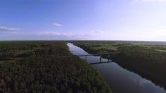 Concrete bridge, blue wide river - aerial Stock Footage