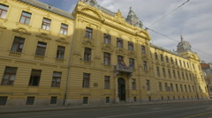 View of the facade of a beautiful old yellow building in Zagreb, Croatia - stock footage