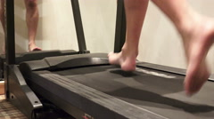 Man running in a gym on a treadmill concept for exercising, fitness and healt Stock Footage