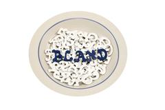 Bowl filled with white letters with blue letters spelling BLAND Stock Photos