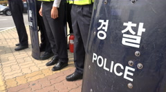 Asia, South Korean riot police officers, shields, protection, guard, security Stock Footage