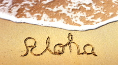 4K Aloha Words Written in Sand, Tropical Hawaii Beach, Travel Vacation - stock footage