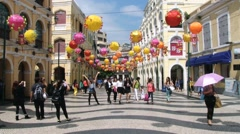 People walk by the Senate square in the historical part of Macau, China. Stock Footage