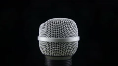 Microphone Rotates on a Black Background Stock Footage
